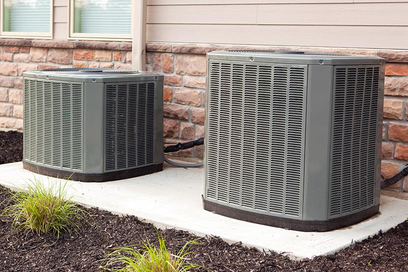 two air conditioner units along a building wall